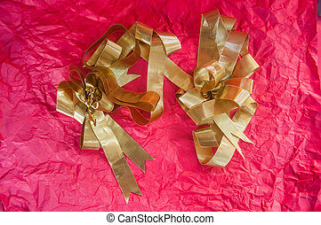 Gold ribbon on red background