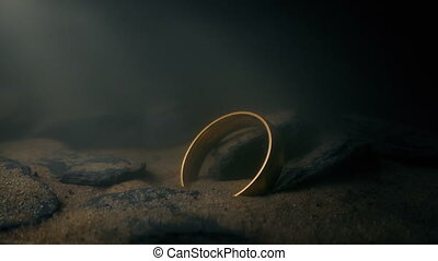 Gold Ring Deep Underwater On The Rocks - Gold ring deep...