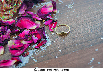 Gold ring, rose petals, rose - focus ring