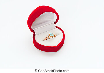 Gold ring with diamond in Red box