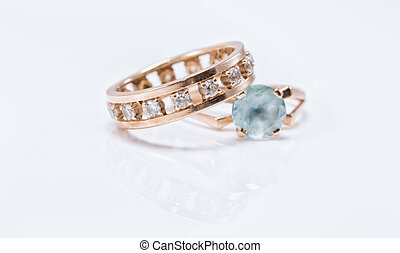 Gold ring with light Topaz and a thick ring with small diamonds