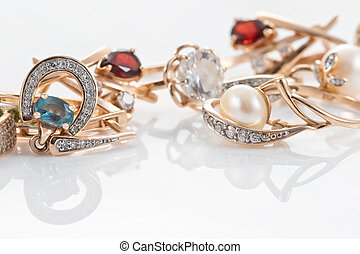A variety of gold jewelry : rings, earrings with Topaz and pearls