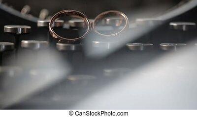 Gold Rings on the typewriter macro Wedding closeup shoot...