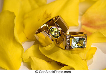 Gold rings with green and blue stones