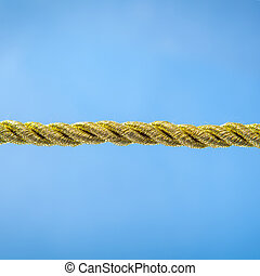 Gold rope on a blue background