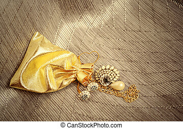 gold sack with vintage jewelry