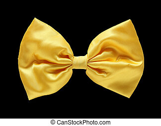 Gold satin gift bow. Ribbon. Isolated on black with clipping path