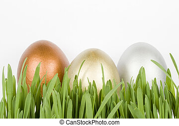 Gold, silver and bronze eggs