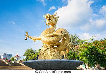 gold statue dragon in Phuket town, courtyard