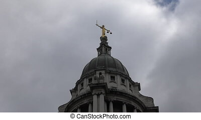 Gold statue of Themis on the dome. - London. England. United...