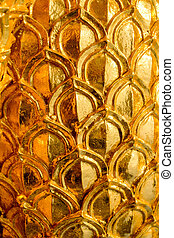 gold stucco design of native thai style on the Wall