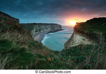 gold sunset over Atlantic ocean coast