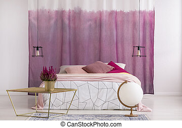 Gold table in pink bedroom