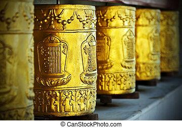 gold tibetan spool in himalayas
