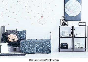 Gold wallpaper in teenager's bedroom