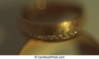 Gold wedding rings on a light background. dream of many girls and women