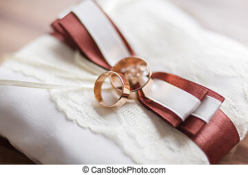 gold wedding rings on the pincushion photo