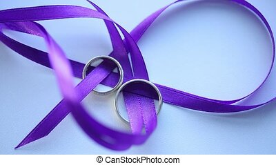 Gold Wedding Rings On the purple ribbon macro closeup shoot...