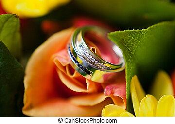 gold wedding rings on the flower