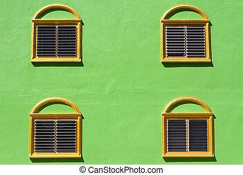 gold window on green wall