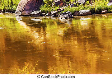 Gold Yellow Brown Colorado River Reflection Abstract Outside Arches National Park Moab Utah USA Southwest.