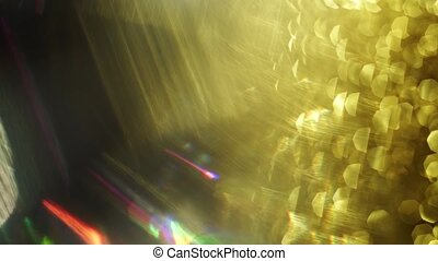 Golden abstract threads and futuristic bokeh shimmer harmoniously in the dark.
