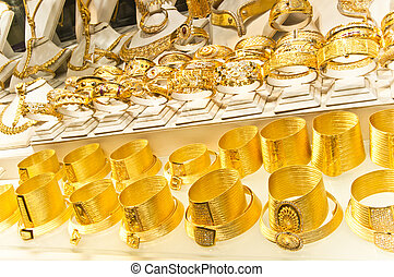 Golden accessories in the display window of a jewellery...