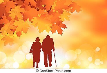 Golden age - Senior couple walking on a fall background