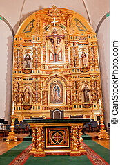 Golden Altar at Mission Basilica San Juan Capistrano Church California.  This is the successor church to the Mission founded by Father Junipero Serra in 1775.