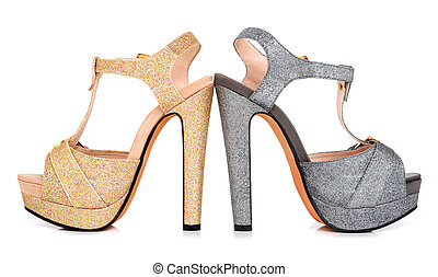 Golden and grey luminous woman shoes isolated on the white ...