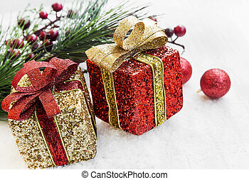 Golden and Red Christmas Presents and Balls in the Snow