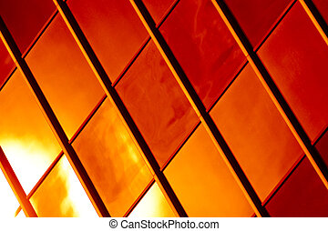Golden and red glass pattern abstract background.