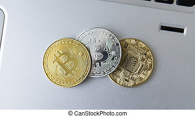 Golden and silver bitcoin coins on a laptop. Digital crypto currency. Virtual money. Metal coins of bitcoin. Bussiness, commercial, Exchange.