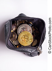 golden and silver bitcoin coins over money coins in wallet around white background