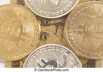 Golden and silver bitcoin with U.S. dollar