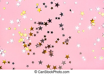 Golden and silver stars on pink pastel background.
