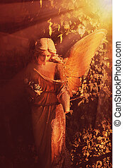 golden angel in the sunlight (antique statue) - angel in the...