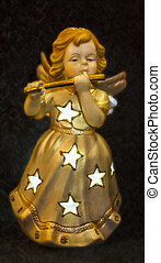 Golden angel playing on flute