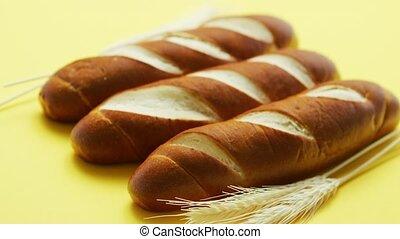 Golden baguettes and wheat ears - Closeup of golden...