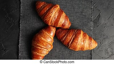 Golden baked croissants on napkin - From above shot of few...