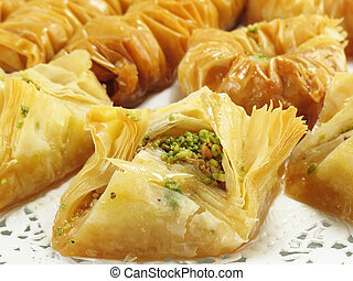 A sweet pastry made of layered phyllo dough, honey and chopped pistachios and walnuts.