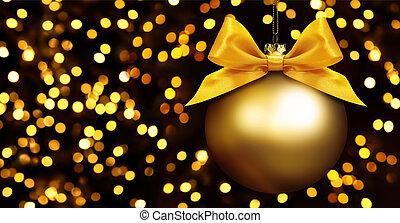 golden ball hanging on lights background