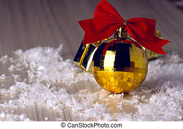 Golden ball with a red bow