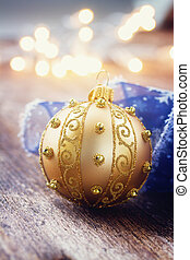 golden ball with christmas lights