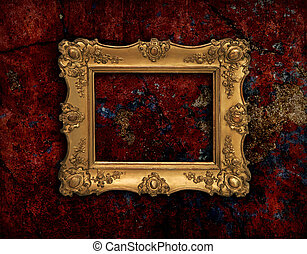 Golden baroque frame on a red grunge texture