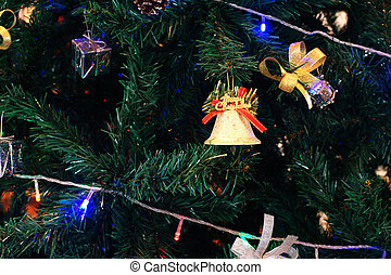 various christmas ornaments decorated on christmas tree