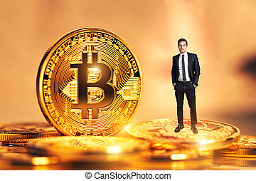 golden bitcoin coin and man