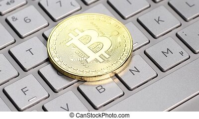 Golden bitcoin coin - Bitcoin cryptocurrency. Golden coin on...