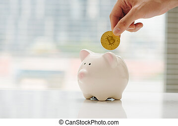 Golden bitcoin coin in piggy bank - symbol of crypto currency. Concept of electronic virtual money for web banking and international network payment