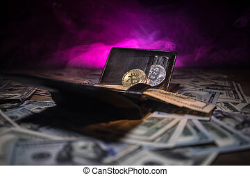 golden bitcoin coin on us dollars close up